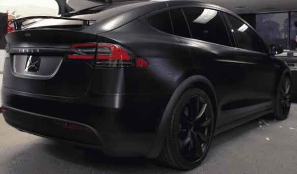 A black Model 3 Tesla with full window tint